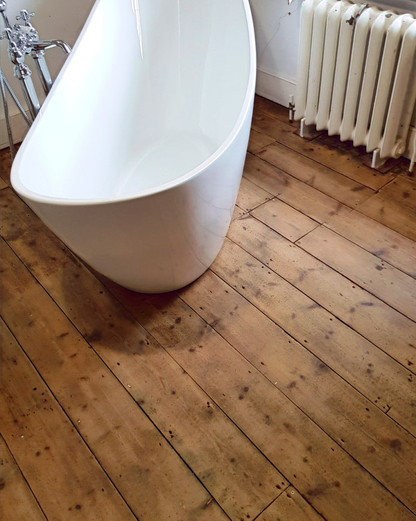 Standalone bath wood flooring