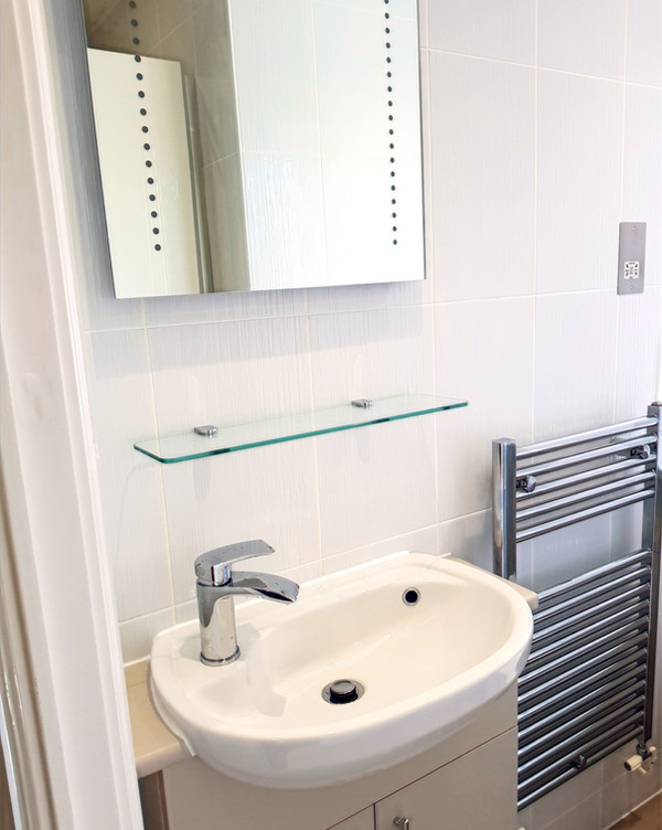 Bathroom sink radiator mirror tiling