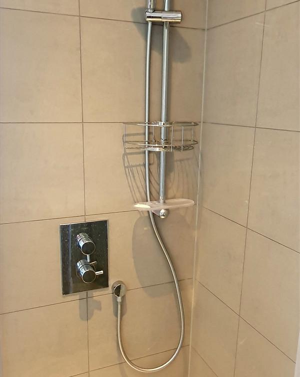 Shower unit tilling