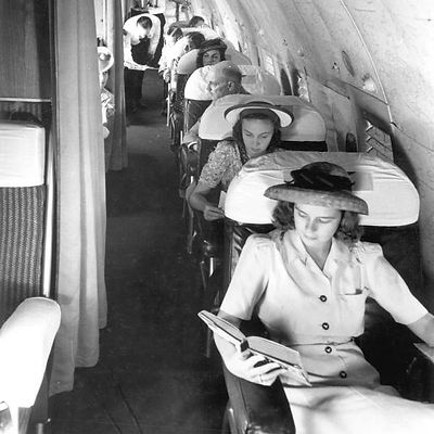 Passemgers riding in a vintage aircraft