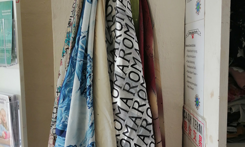 Secondhand scarfs priced @ each