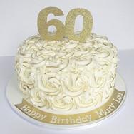 Gold rosette 60th birthday cake