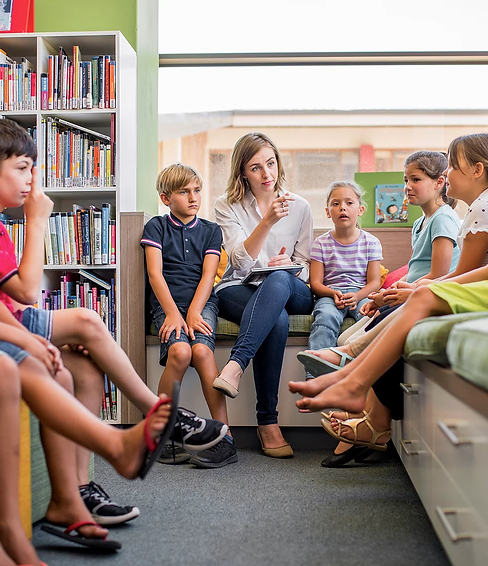 teacher and children in library