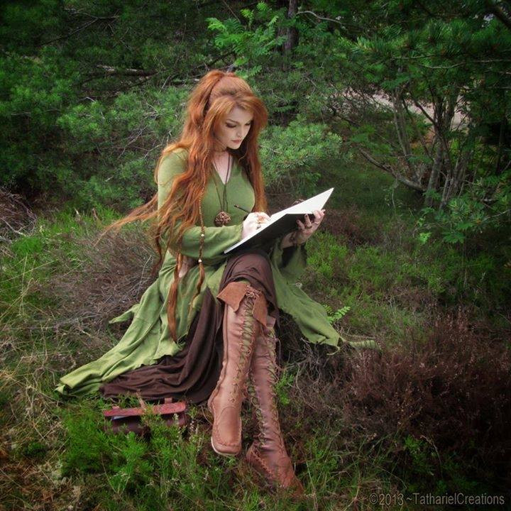 Fire-Haired Witch in Green Reading Her Grimoire in the Forest