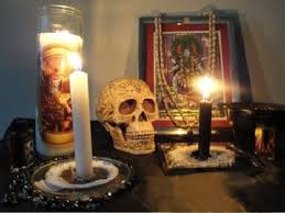Hoodoo Spell with Archangel Candle, Skull, Black and White Candles, and Prayer Beads