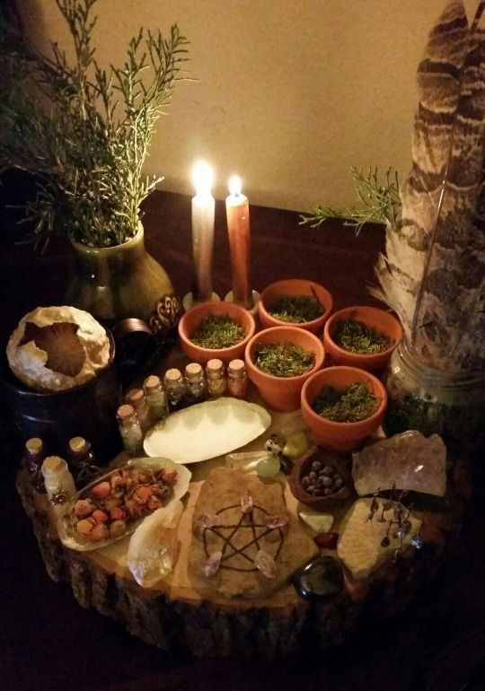 Herbs, Oils and Candles Sitting on an Altar