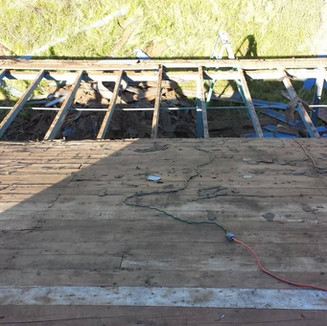 Replacing dry rot sheathing and rafters.