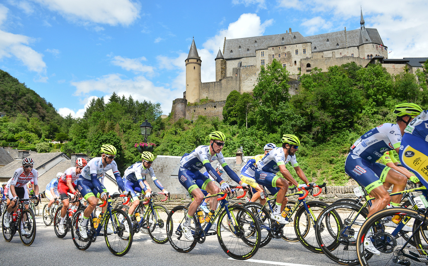 The peloton in front of the medieval castle of Vianden during stage 3 of the Skoda Tour de Luxembourg 2019.
