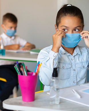 girl-putting-on-her-medical-mask-in-class.jpg