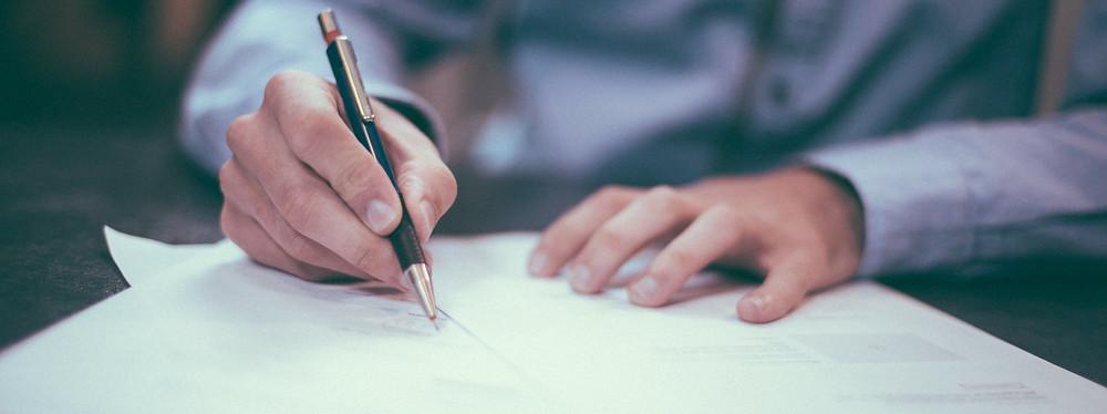 Man writing audit report