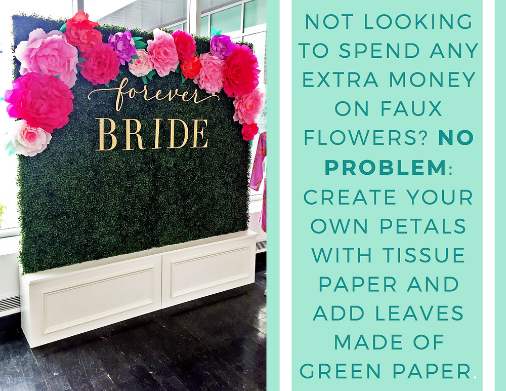Tissue paper flowers on boxwood greenery photo backdrop for wedding