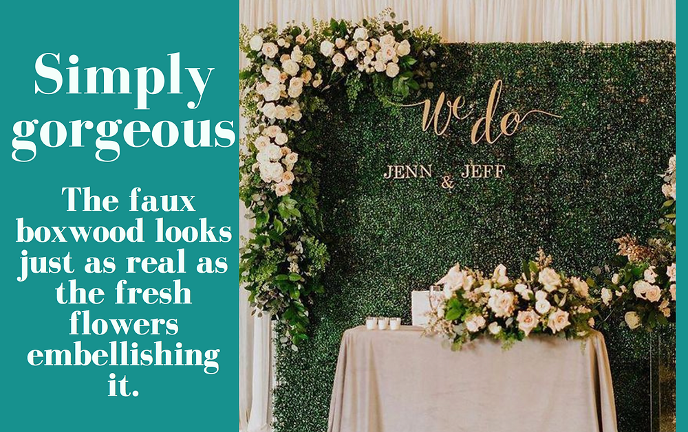beautiful faux boxwood greenery panel wedding backdrop with fresh flowers