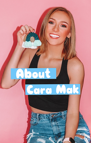 Cara Clements holding a mini rainbow keychain against a pink background. Link to learn about company