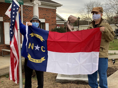 A New NC Flag Flies in Front of Town Hall