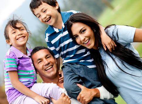 Happy family having fun outdoors and smi