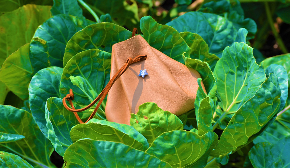 MS' Reclaimed Leather Mini Drawstring Cross Body Purse Medicine Bag amidst the brand's studio-based cabbage patch.