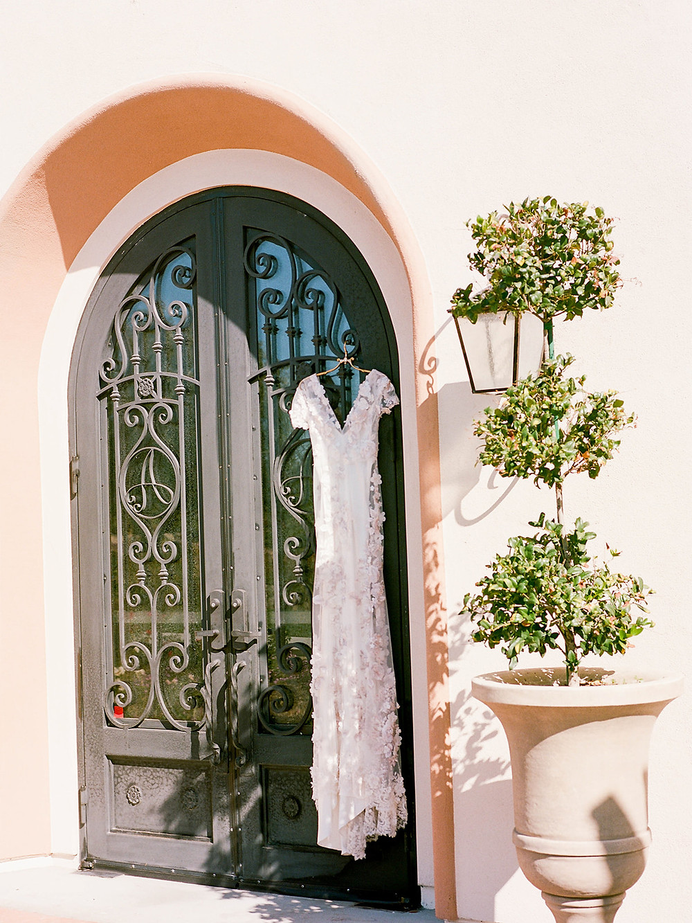 wedding dress hanging in door at Avensole Winery