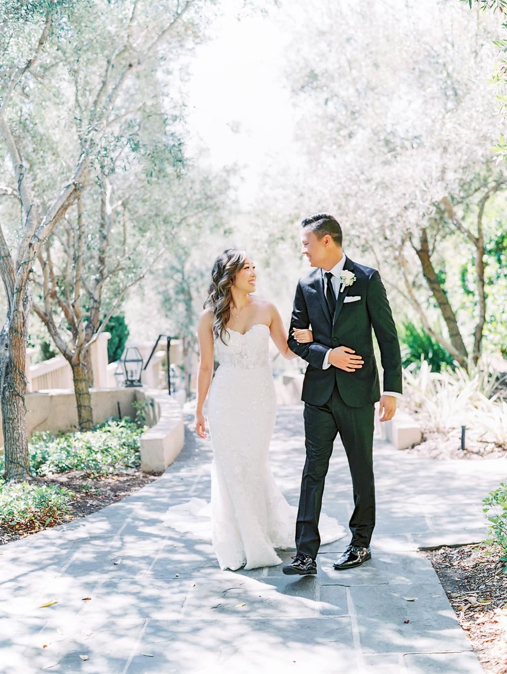 couple walking rancho bernardo inn wedding