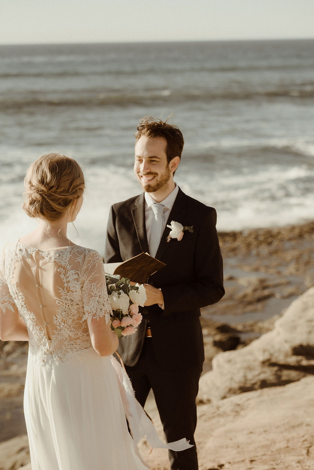 Groom smiling during the wedding ceremony