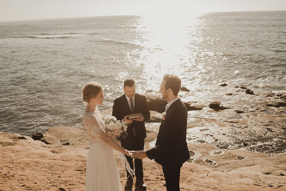 wedding ceremony at the ocean at sunset cliffs