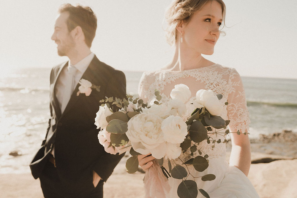 Bride and Groom with a white bouquet