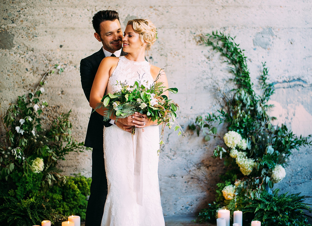 bride and groom hugging at Luce Loft wedding