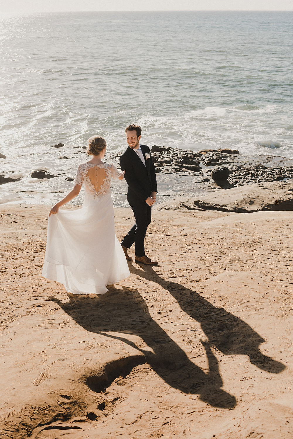 bride and groom first look at sunset cliffs