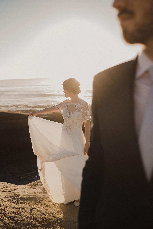 Bride holding her dress at Sunset Cliffs