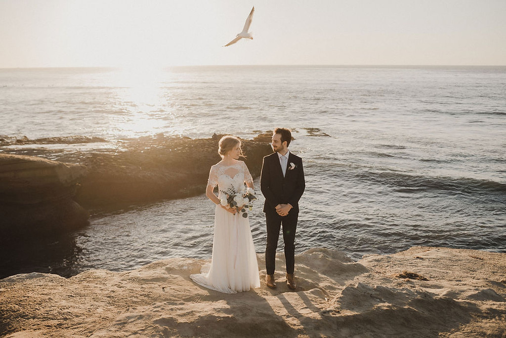 Bride and Groom with a bird flying above them