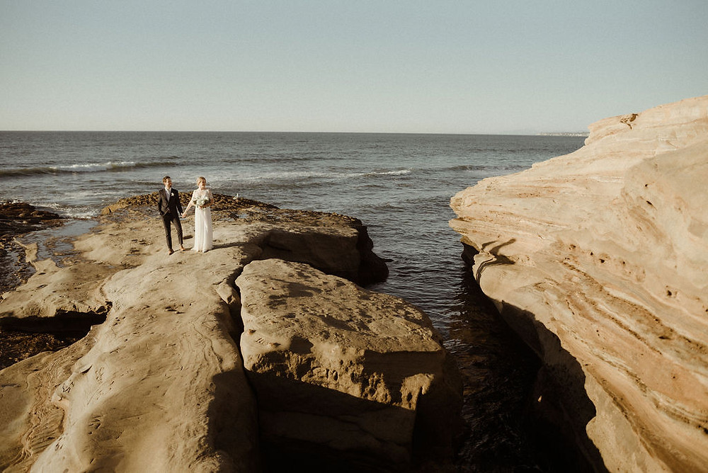 Landscape photo of a Bride and Groom at Sunset Cliffs