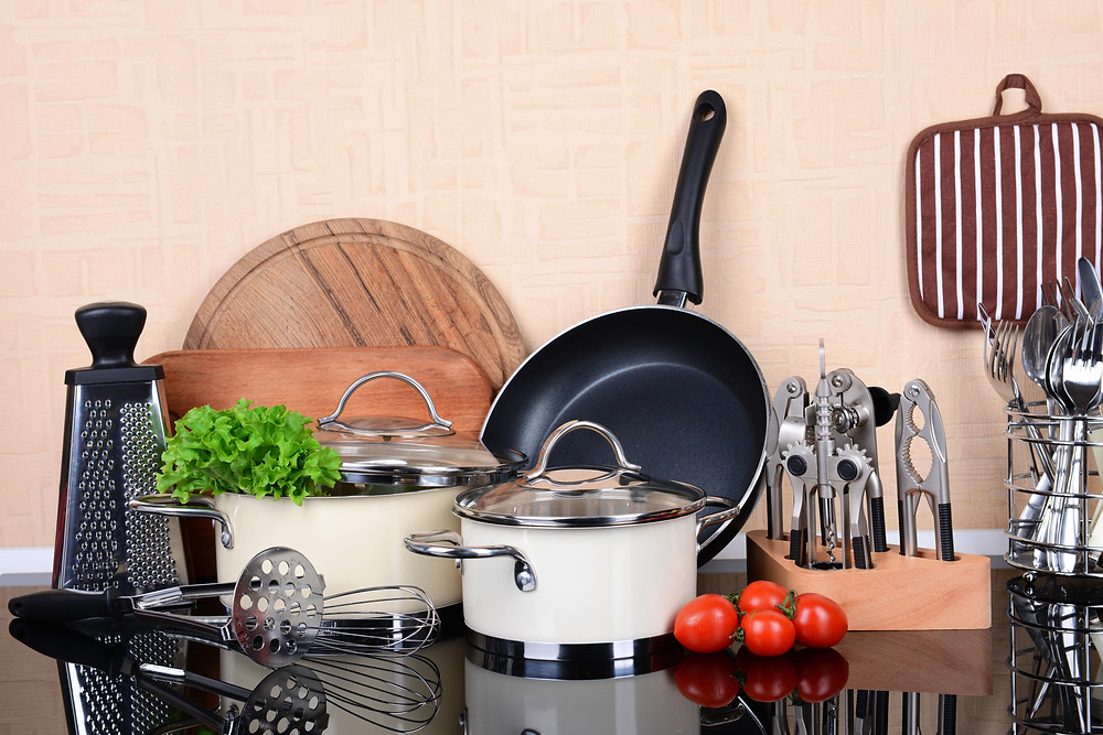 cooking utensils: pots, pans, whisk, cutting board, can openers, masher, grater