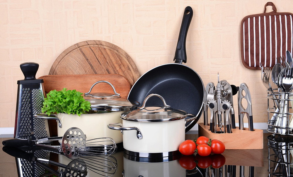 cooking tools: pot, pan, cutting board, tomatoes, whisk, masher