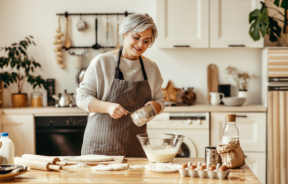 An older adult learning to bake at home