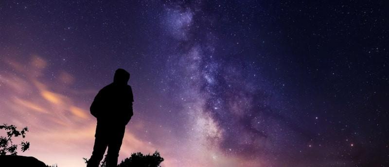 man stargazing