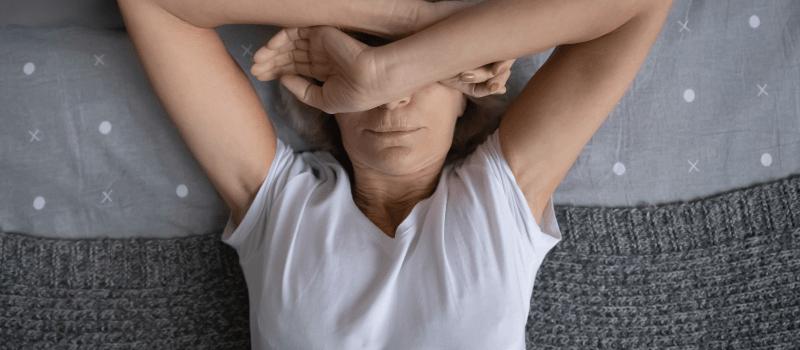 Senior woman lingering in bed