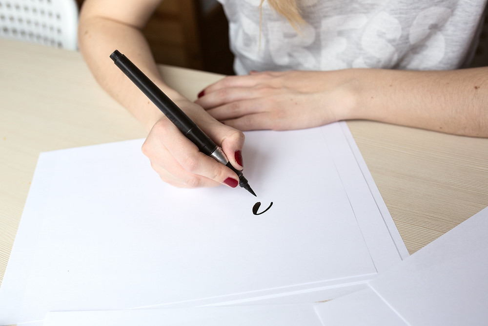 woman writing calligraphy