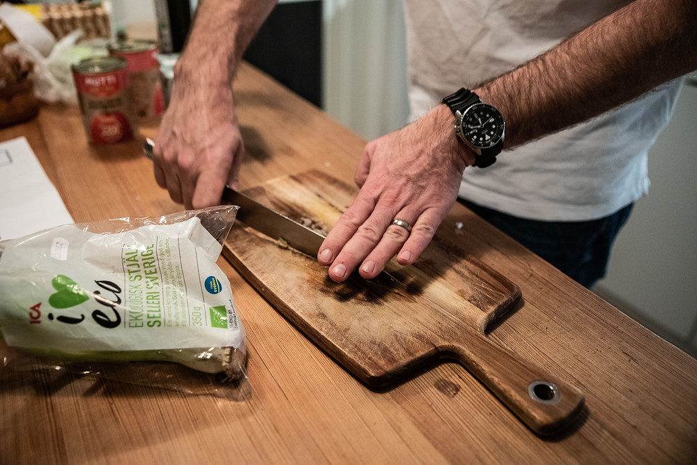 man chopping onions on a cutting board