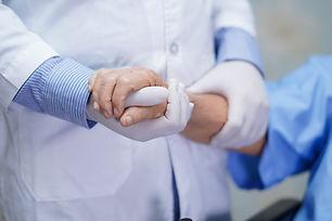 Doctor holding touching hands Asian seni