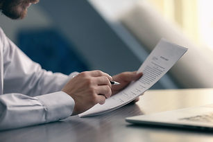 Businessman reading documents.jpg