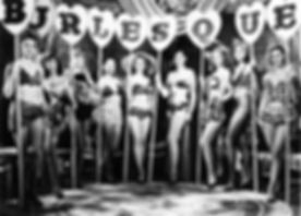 Girls holding the letters that spell out the word burlesque.jpg