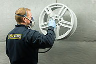 Alloy wheel refurbishment spraying.