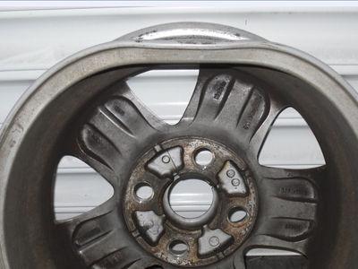 Buckled alloy wheel before Pro Alloys straightening