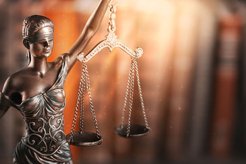 vasilic law firm lady holding scales