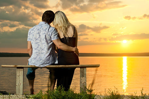Pre & Postnuptial Agreements picture of couple hugging watching the sunset happy