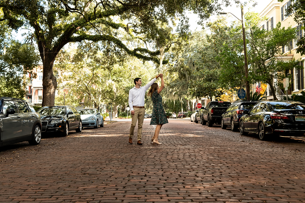 David proposes to Ally in front of the Forsyth Park fountain in Savannah, Georgia.