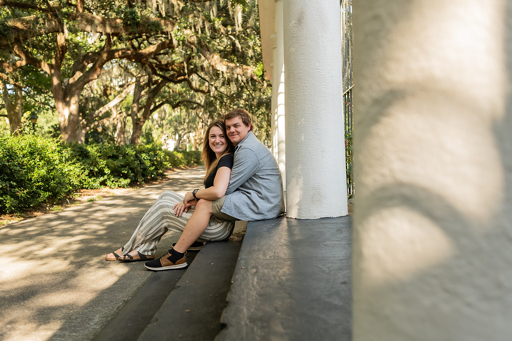 Connor proposes to Hannah in front of the fountain at Forsyth Park in Savannah, Georgia.