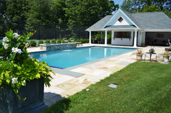 Pool, pool house and raised spa with scheer descent