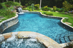 Pool with raised spa and waterall groto
