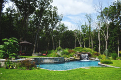 Pool with waterfall groto and raised spa