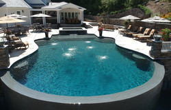 Pool and raised spa with a scheer descent, laminars and vanishing edge.